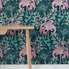 Dogwood buds and foliage grow amongst Matthiola Arborescens blooms on this teal and pink wallpaper.