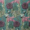 Laburnum flowers with Rhododendrons and Pom-Pom Dahlias on this floral, teal wallpaper.