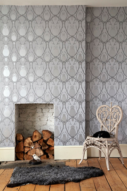 Silver metallic wallpaper featuring hand-drawn owls sitting on branches.