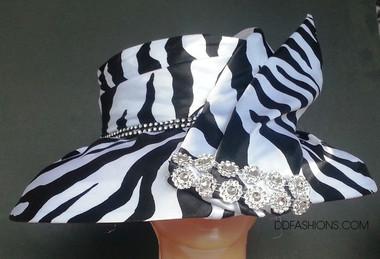 Ladies down brimmed elegant hat with animal print