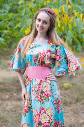 """Beauty, Belt and Beyond"" kaftan in Rosy Red Posy pattern"