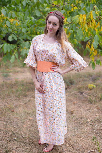 """Beauty, Belt and Beyond"" kaftan in Starry Florals pattern"
