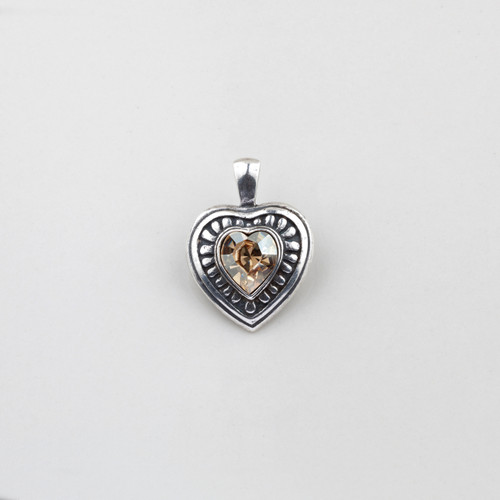 Golden shadow Swarovski® Crystal heart pendant with a patterned burnished silver edge
