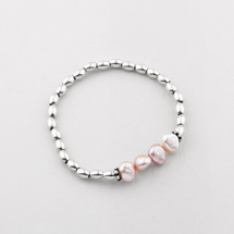 Silver bead and pink freshwater pearl stretch bracelet.