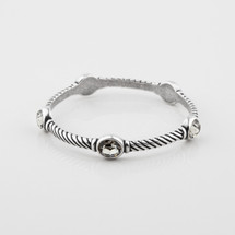 Desirable burnished silver rope-detail bangle encrusted with black diamond Swarovski® Crystals.