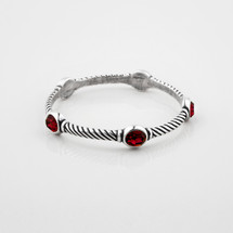 Desirable burnished silver rope-detail bangle encrusted with siam Swarovski® Crystals.