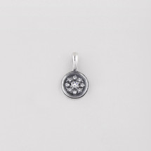 Petite burnished silver disc pendant created with Swarovski® crystals