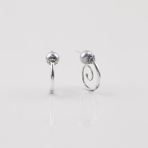 Burnished silver plated hoop earrings adorned with blue shell pearls.