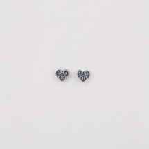 Burnished silver plated heart stud earrings.
