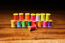 Glo Brite Floss (Top Row Left to Right- Flo. Hot Orange, Flo. Fire Orange, Flo. Orange, Flo. Fuchsia, Flo. White, Flo. Yellow Chartreuse, Flo. Yellow; Bottom Row Left to Right- Flo. Hot Yellow, Flo. Blue, Flo. Chartreuse, Flo. Highlander Green, Flo. Flame, Flo. Sunburst Amber, Flo. Hot Pink, Flo. Purple; Front Middle- Flo. Red)