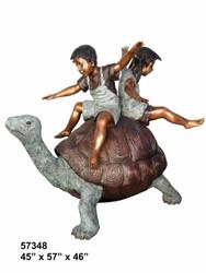 2 Kids Balancing on a Tortoise