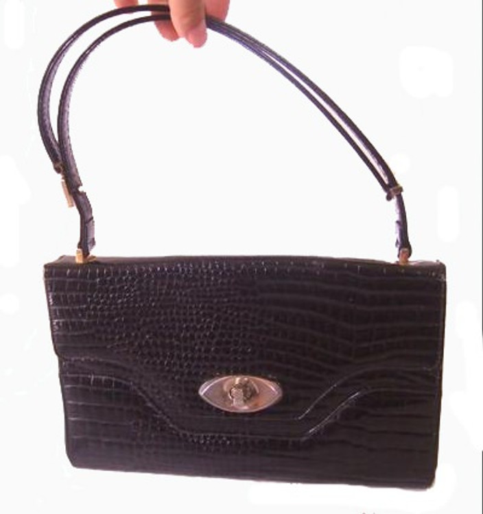 Black embossed patent leather handbag