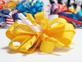 Yellow twirl polka dot hair bow w french clip