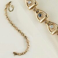 A 14k gold linked small stirrup and buckle bracelet with Sapphires and Diamonds