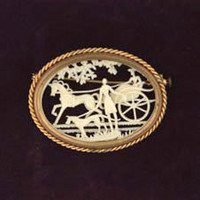 Oval Celluloid Brooch with Carriage, Horse and Hound.