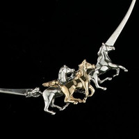 "Striking sterling silver and 14k gold 3 galloping horses neckpiece. Flattering 17"" length."