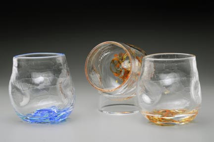 "Crackle Thumblers are hand-sculpted and freeblown, no mold. Crackle appearance/texture and thumb/finger depressions for a ""no slip grip""!  These fun to hold, and drink from glasses are approximately 3 X 3 inches. Currently offered in ""Summer Seas"" (blues, little white and green), shown on left, and Autumn Splendor (amber/orange/red blend), center and right. Please specify color preference in Order Notes and/or contact me with any questions."