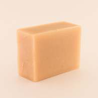 Unwrapped bar of discounted Shea Butter goat milk soap.