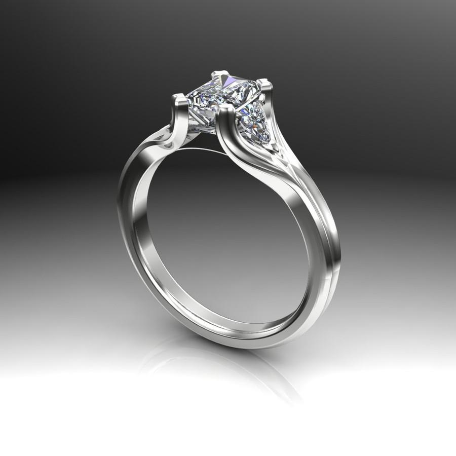 3 stone engagement ring emerald cut diamond