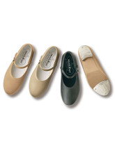 Professional grade tap shoe without the bothersome ribbon  Synthetic leather upper Slip-on design with elastic buckle strap Non-slip rubber patch and professional grade Revolution taps with fiberboard Medium width only Whole and half sizes