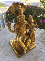 This beautiful Laksmi-Nrisimha Murti has some brass oxidation which can be removed with brass polish.