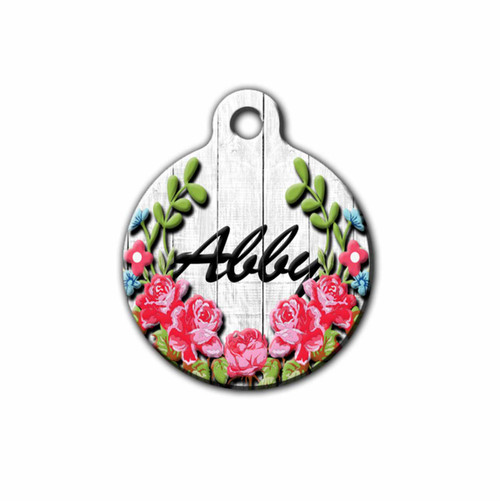 Beautiful pink Floral Pet tag with wood background and the pets name on the front | Blue Fox Gifts