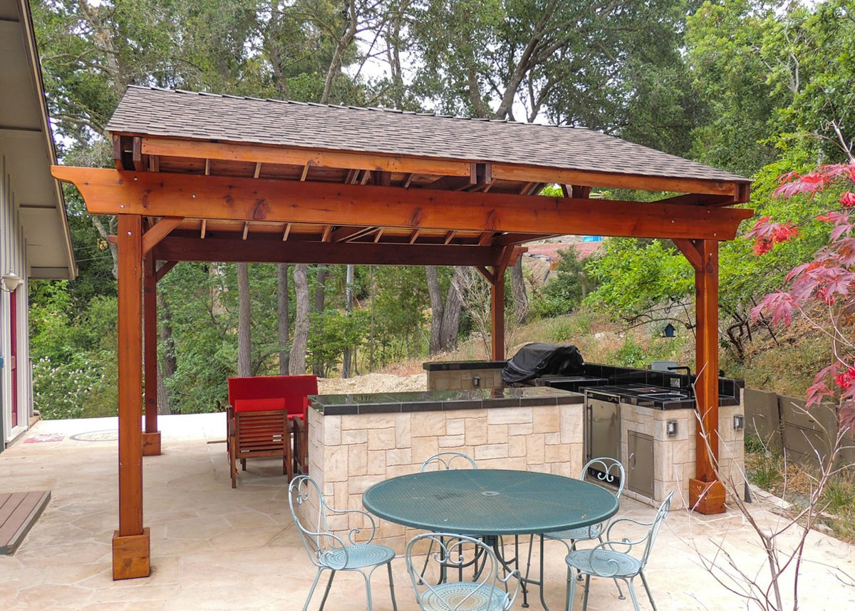 covered pergola over an outdoor kitchen