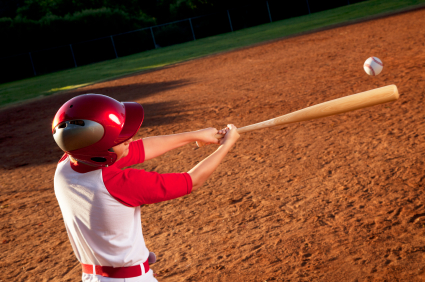 youth hitting with a wood bat