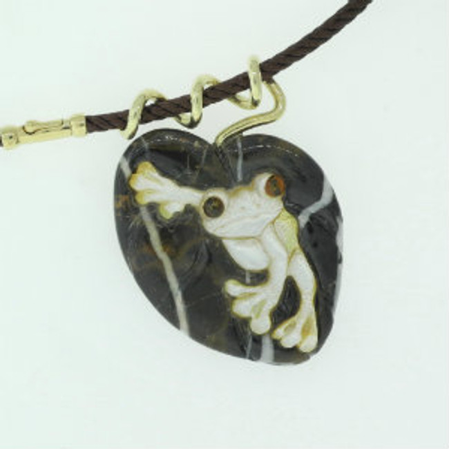 Gold Pearl carved tree frog on a carved marble leaf with heavy 14kt gold twisted stem bail by Paul Grussenmeyer.