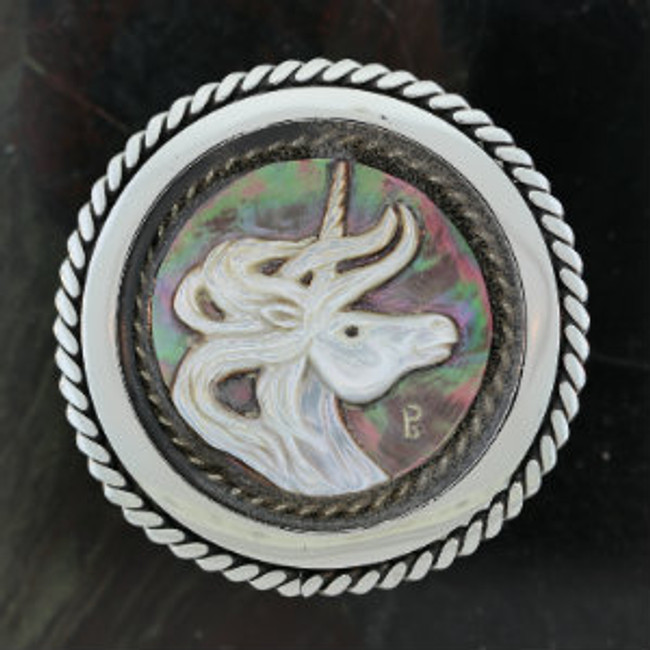 Carved black mother-of-black pearl unicorn cameo by Paul Grussenmeyer. Mounted on a stainless steel belt buckle.