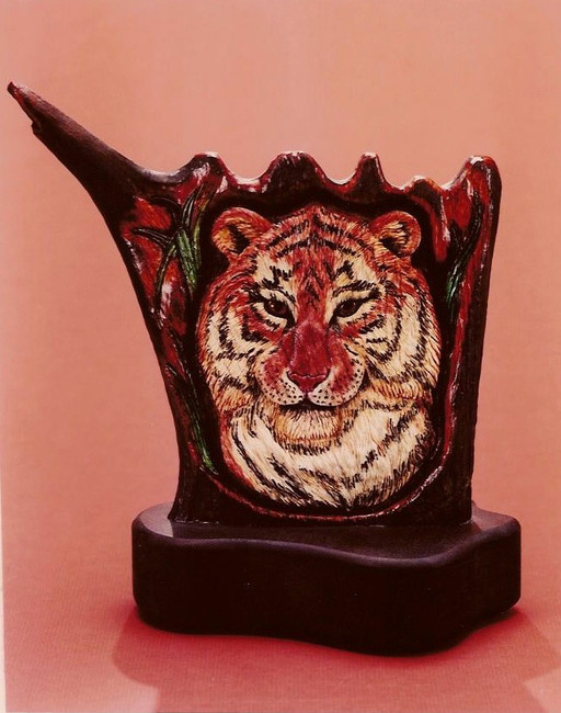 """Siberian Stare"". Carved American Moose Antler lifelike sculpture by Paul Grussenmeyer. The palm part of the moose antler used for this sculpture of a Siberian tiger. Rhodolite garnet eyes were set and cut out from behind, then back filled with clear resin. It can be backlighted to make the eyes come alive. Heavy walnut base."