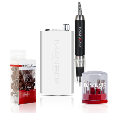 The MANIPro Passport® WHITE Bundle Includes 1 each:  MANIPro Passport® WHITE (Portable Electric Nail File)    Acetone Resistant Finish Control Box!   KUPA's MANIPro Passport®. This powerful, all new exclusive, portable electric nail file has been designed for the Professional Nail Technicians who demand power and portability.  The MANIPro Passport® features a light weight battery powered *Acetone Resistant Finish* control box. This unit can provide anywhere from 8 to 10 hours of use per charge in either 110v or 220v.  The MANIPro Passport® comes complete with a stainless steel belt clip and a plastic handpiece holster which can snap on either side of the control box.  Control box is also available in Purple, Red or White. Full one year parts and labor warranty with your Kupa E-file!  CONTENTS:  * KP-55 Handpiece * Passport® Portable Control Box * Passport® Charging System * Stainless Steel Belt Clip * Plastic Handpiece Holster * Instruction Manual  FEATURES:  * Ultra Smooth / Quiet / Vibration Free * Acetone Resistant Finish Control Box * Compact Light Weight * Portable/Rechargeable * 8-10 Hours of Battery Life * Variable Speed Control * Forward/ Reverse Button * Illuminated Power Indicator * High Torque / 30,000 RPM * Quick Charge System - 2 Hours Full Charge * Automatic switching 110/220 Volts * Limited One Year Warranty  Compatible Handpieces:   U-Power Model:  * UG-12 (UP200 Handpiece) * UG-14 (UPower 2G & UP200-V Handpiece)  MANIPro® Model:   * KP-36 (Supermax Handpiece) * KP-50 (MANIPro® Handpiece) * KP-55 (MANIPro® Handpiece)     The K-Star Carbide bit kit is available in a stylish cylindrical container that displays each bit for easy organization.  Silver K-Star Carbide Bit Kit Contains:   1. CSBX-32-002-S  Silver 3/32 Two Week Backfill Bit 2. CSBX-32-004-S  Silver 3/32 Four Week Backfill Bit 3. CSBX-32-006-S  Silver 3/32 Four Week Inverted Backfill Bit 4. CSBX-32-010-S  Silver 3/32 Cone 5. CSBX-32-015-S  Silver 3/32 Under Nail Cleaner 6. CSBX-32-018-S  Silv