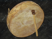 Hand drum made of yellow pine and genuine goat rawhide. 7""
