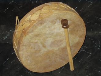 "Hand drum made of yellow pine and genuine goat rawhide. 7"""