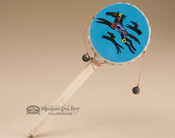 This is a hand made rawhide spinner drum.