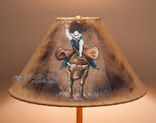 Rodeo bull rider painted leather lamp shade.