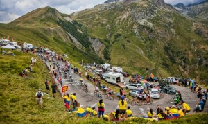 Col du Glandon, France - 24 July 2015: The peloton riding in a beautiful curve at Col du Glandon in Alps during the stage 19 of Le Tour de France 2015.