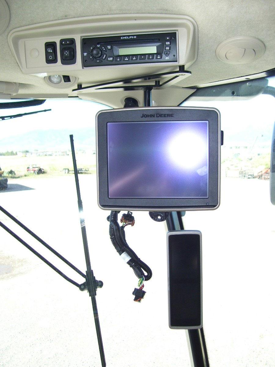 Quick Change Bracket on John Deere 2630 Display in combine using the under radio bracket.