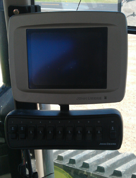 Ten Switch Controller with 2600 John Deere display with bracket installed on back of display.