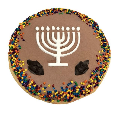 Chanukah Frizza - Chocolate Vanilla Frozen Dessert decorated with a Menorah, chocolate Dreidels and colorful mini chocolate chips.