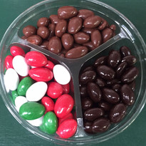 A sweet trio of dark chocolate almonds, holiday Jordan almonds, and milk chocolate Jordan almonds.