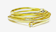 Looped 18k lemon-green gold ring with two diamonds