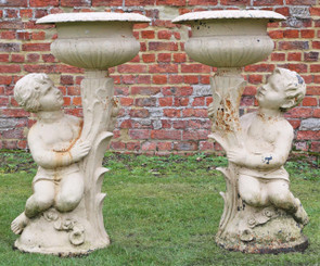Antique pair of large of cast iron planters urns plant pots boy girl