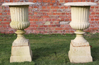 Antique classical pair of cast iron planters urns on plinths