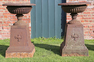 Large antique pair of Victorian cast iron planters classical urns on plinths