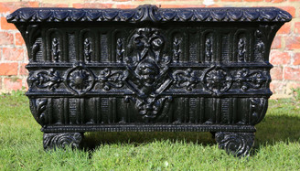 Antique cast iron pot planter trough