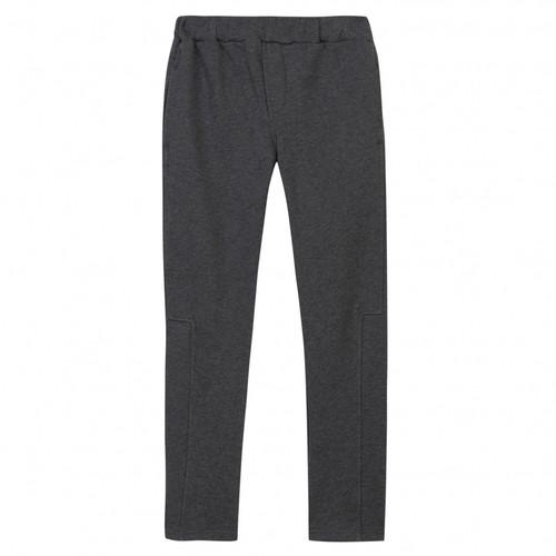 Kenzo grey pants in front.