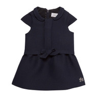 Tartine et Chocolat navy dress with bow on front.