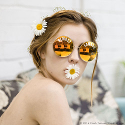 "Dreamer, a golden pair of sunglasses designed for free-spirits, includes lens tattoo phrases such as 'Wild Child,"" ""Almost Famous,"" ""Lover Dreamer,"" and ""Dazed Confused"" in metallic silver. sunnies set includes 8 different lens tattoos in 4 unique designs made specifically for Flash Tattoos sunglasses to be customized in a few simple steps!"