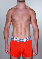 Baskit Light Trunk in blood orange color front.